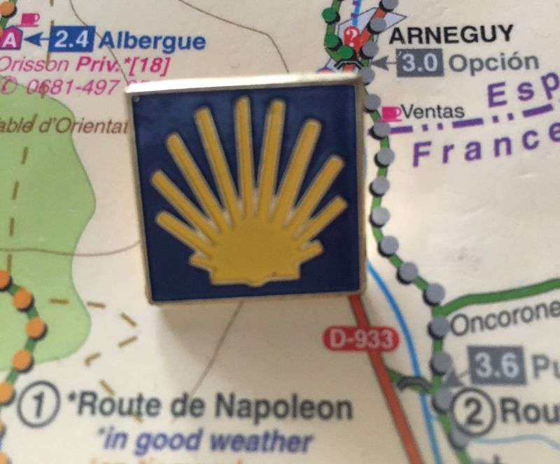 blue and gold pin on a map