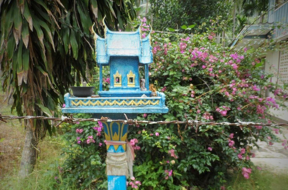 spirit house in a garden in Thailand