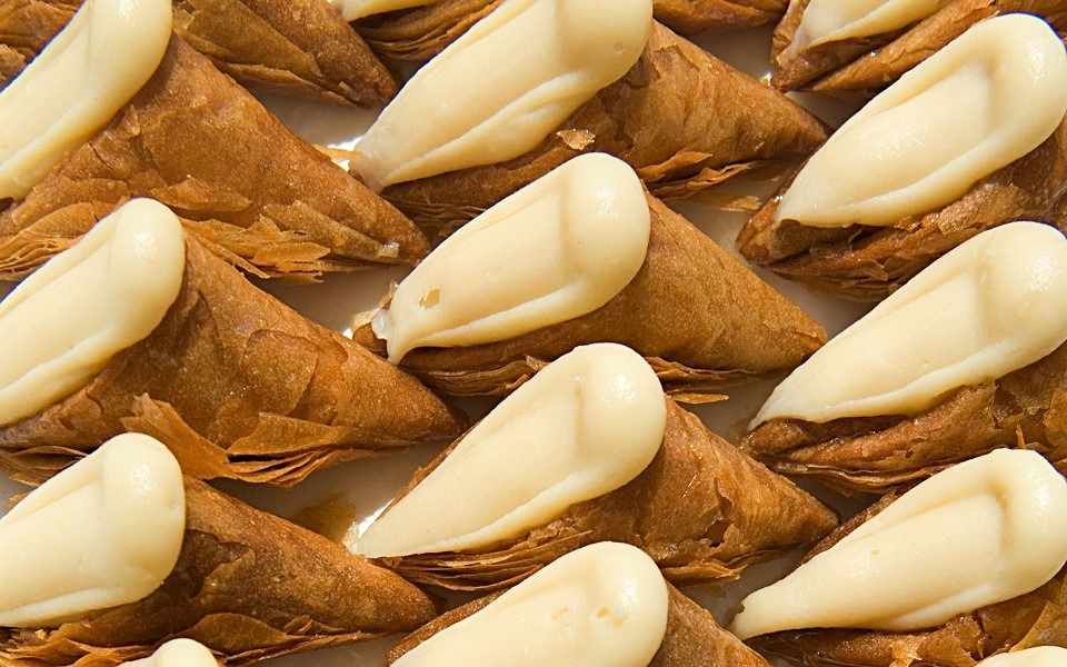 close-up of cream-stuffed pastry triangles