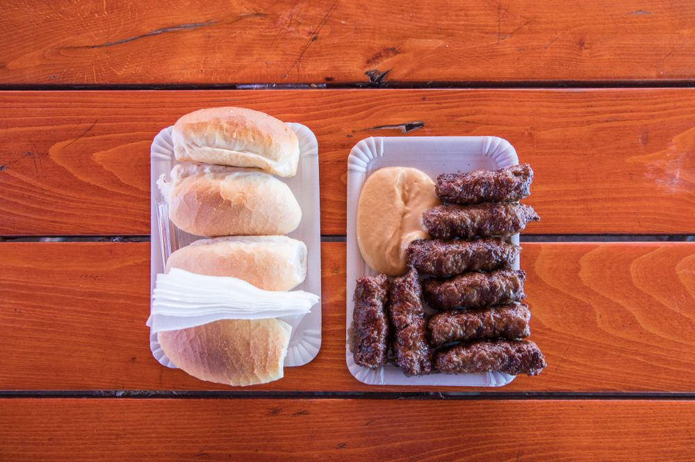 overview shot of a plate of sausages with buns
