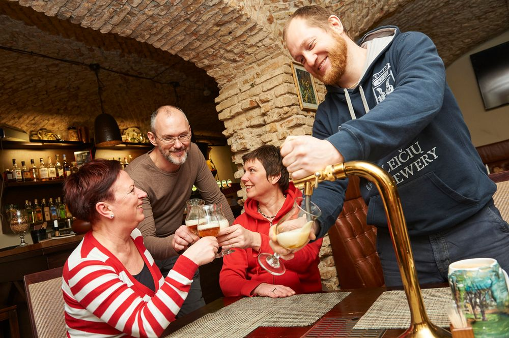 travellers cheersing in a pub