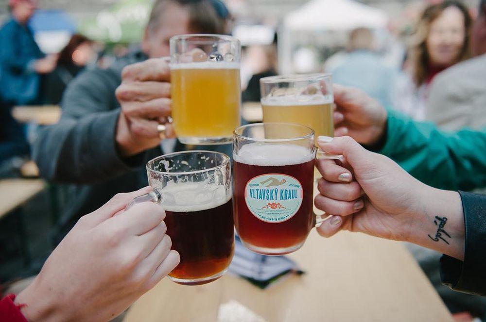 glasses of beer being held up in a cheers