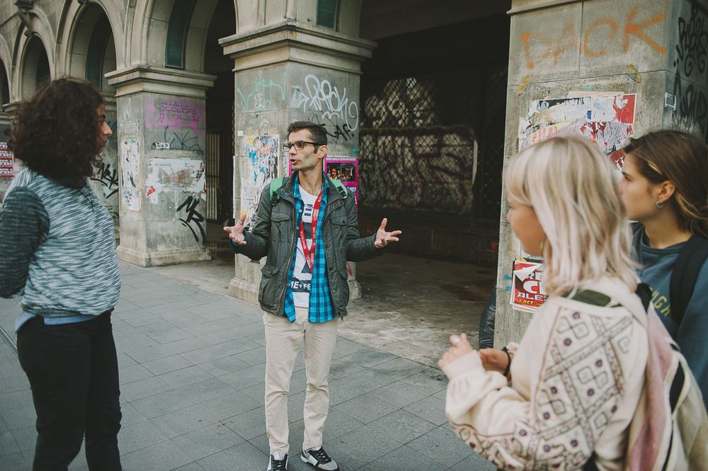 tour guide leading a group in Bucharest