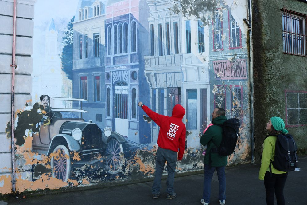 tour guide and travellers looking at street art in Punta Arenas