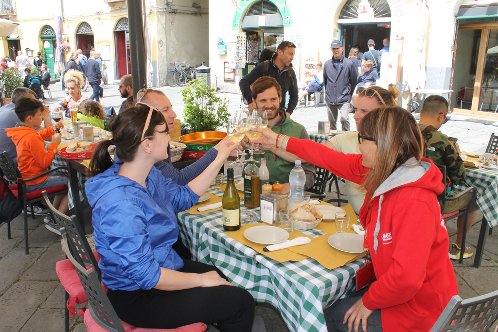 travellers drinking wine with a guide