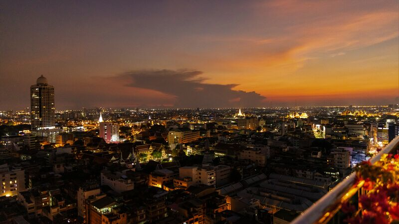 Escape the heat of the city and enjoy the views instead with a cocktail at sunset in one of the many chic sky bars that dot the city. Photo credit: Bangkok Urban Adventures