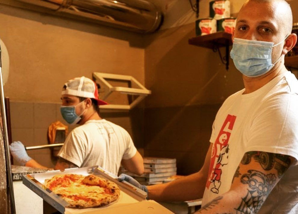 two pizza makers wearing masks