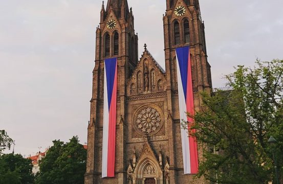 church with the Czech flag hanging